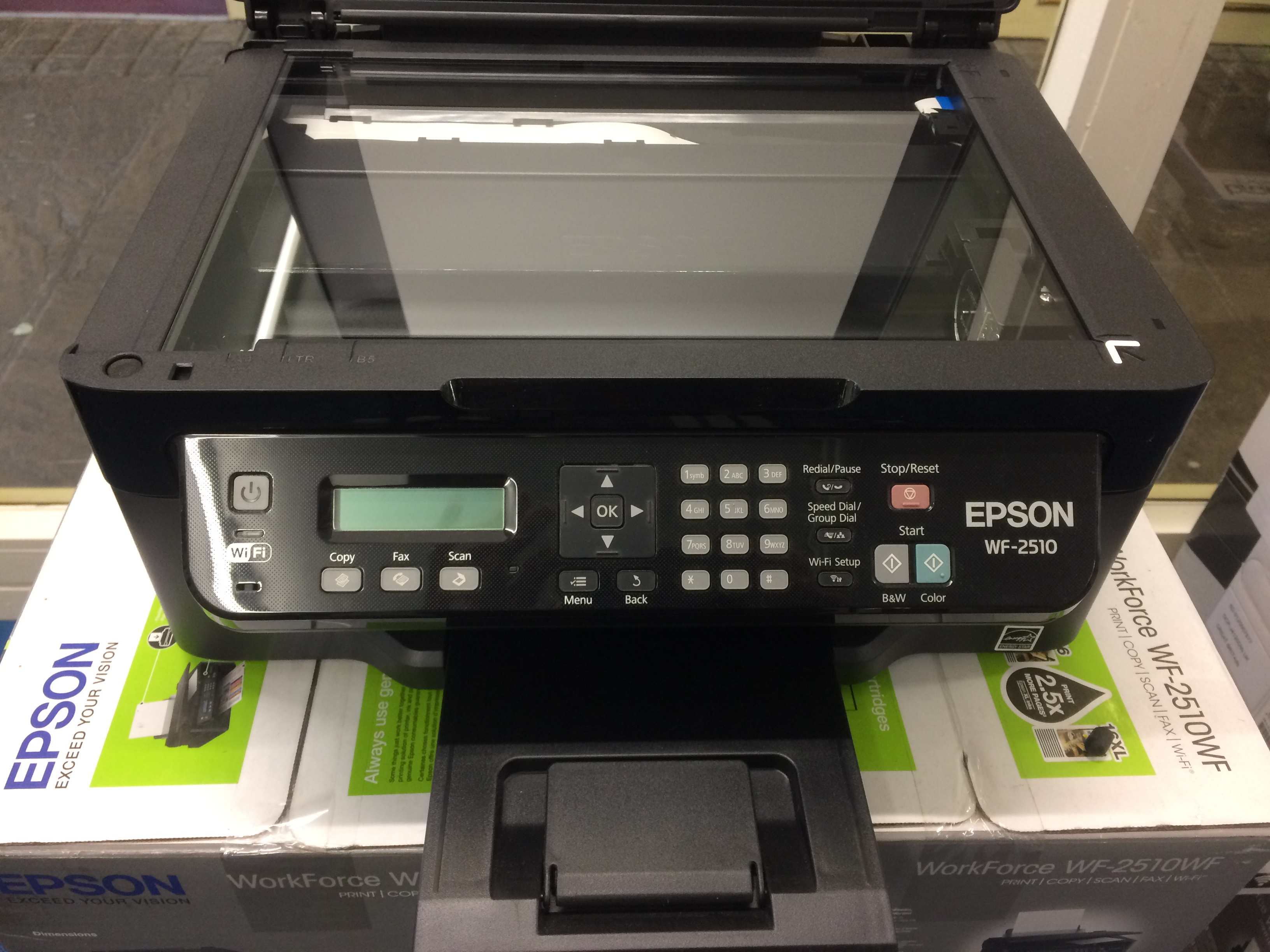 Epson Workforce WF-2510WF Printer With Scanner Lid Up.